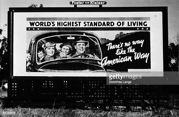Billboard, sponsored by the National Association of Manufacturers, on Highway 99 in California during the Depression. It reads 'There's no way like...