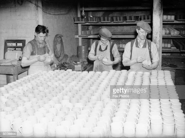 Commemorative mugs for the coronation of George VI being made at a pottery in Ewenny near Bridgend in Wales