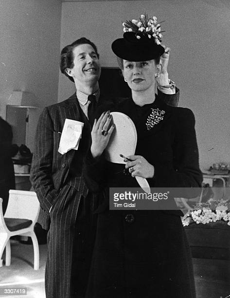 Danish milliner Aage Thaarup and a mannequin modelling one of his designs, an Easter bonnet decorated with snowdrops, at his Mayfair salon, London....