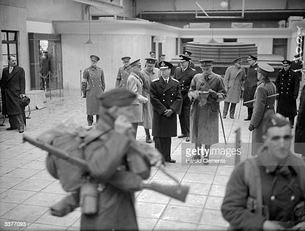 King George VI in naval uniform watching BEF troops as they disembark at Dover Kent