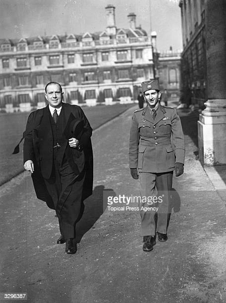 King Peter of Yugoslavia and his Master H Thinkhill take a walk in Clare College Cambridge