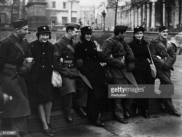 US soldiers sit arminarm with AFS girls in a London square