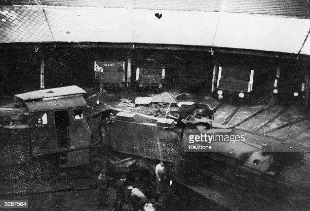 Photograph shows the Rail Depot at Annambose after a sabotage attack which took over 75 hours to clear up
