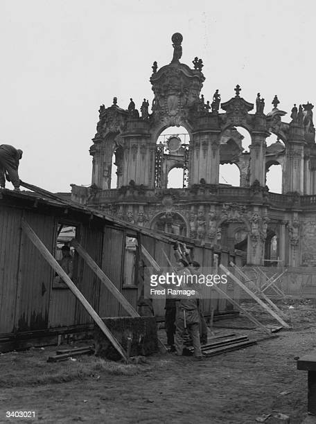 A shed is erected for the Clerk Of The Works who will supervise the reconstruction of the famous Zwinger Art Gallery after the devastation caused by...