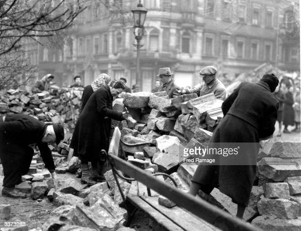 Although Sunday is a day of rest in Dresden volunteers continue to help clear the bomb damage debris