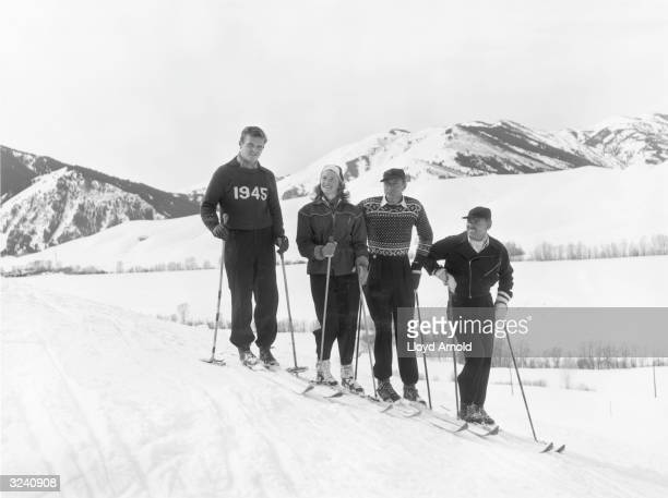 From right to left American actors Clark Gable and Gary Cooper ski with Swedishborn actor Ingrid Bergman and Jack Hemingway eldest son of writer...
