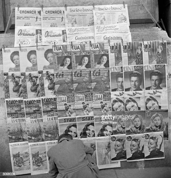 In post war Rome well stocked kiosks sell newspapers and pornography