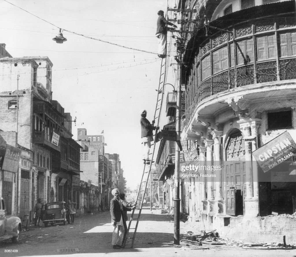 Telephone linesmen restoring communications after riots in Amritsar holy city of the Sikhs in the Punjab