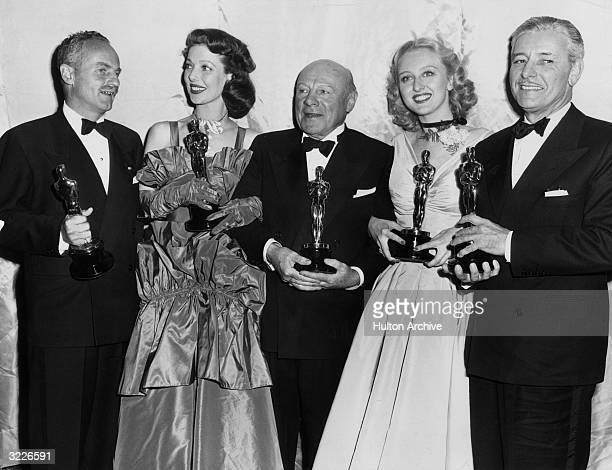 Oscar winners at the 1947 Academy Awards LR Best Producer Darryl Zanuck Best Actress Loretta Young Best Supporting Actor Edmund Gwenn Best Supporting...