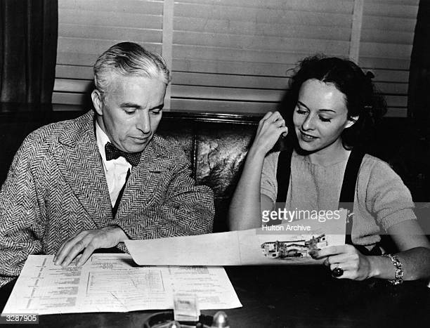 Sir Charles Spencer Chaplin English film actor and director with former wife actress Paulette Goddard at the Brown Derby Cafe The two were divorced...