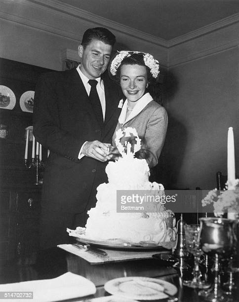 March 1951Hollywood CA Actor Ronald Reagan and his bride starlet Nancy Davis stand behind their wedding cake after their marriage here