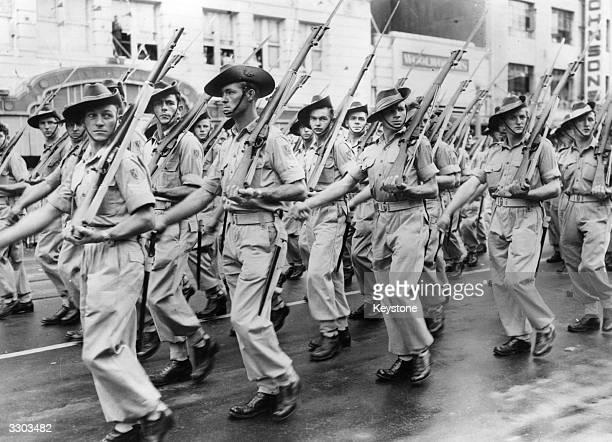 Australian soldiers parade past Sydney Town Hall on their way to the Korean War.