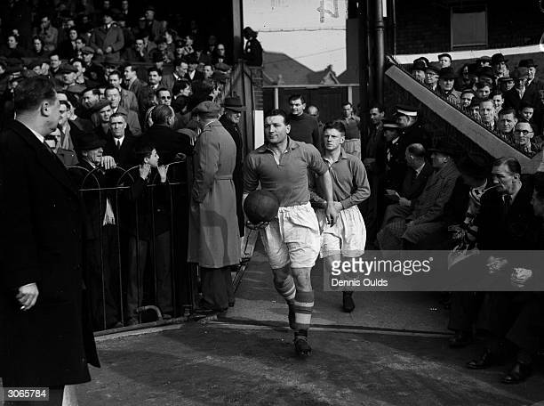 Liverpool captain Bob Paisley leading the team on to the pitch, a former Durham coal miner, he went on to manage Liverpool and became the most...