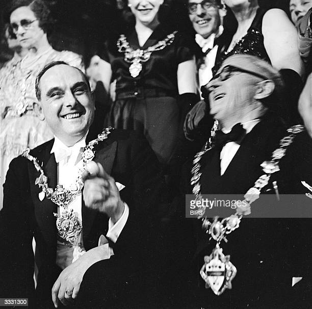 Two mayors laughing during the world's only Mayoral Marbles Championship held in Wakefield Yorkshire where marble making is a new industry At the...