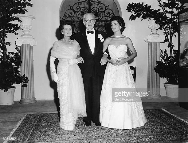 EXCLUSIVE Fulllength portrait of Rose Kennedy and her husband American financier Joseph Kennedy posing with their daughterinlaw Jacqueline Kennedy at...