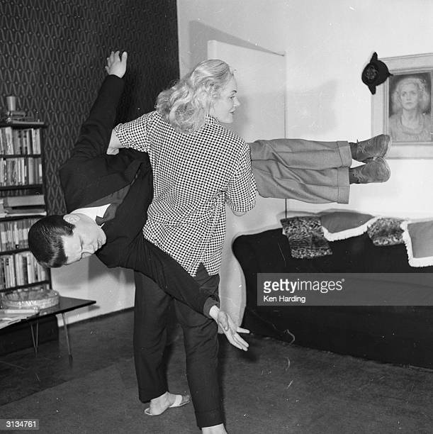 Glamorous strongwoman Joan Rhodes apprehends a wouldbe burglar in her flat in Hampstead north London