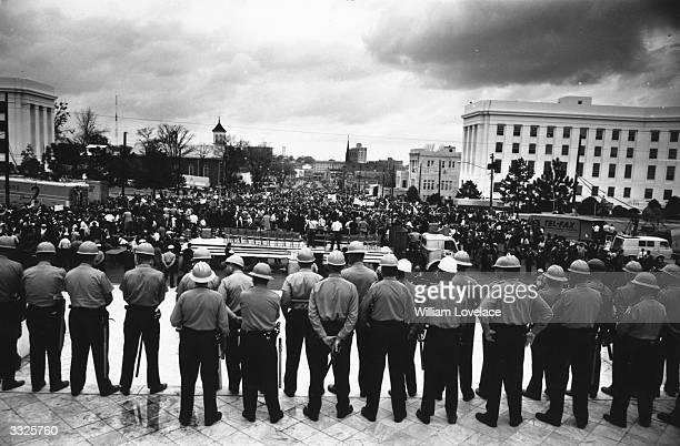 Line of policemen on duty during a black voting rights march in Montgomery, Alabama. Dr Martin Luther King led the march from Selma, Alabama, to the...