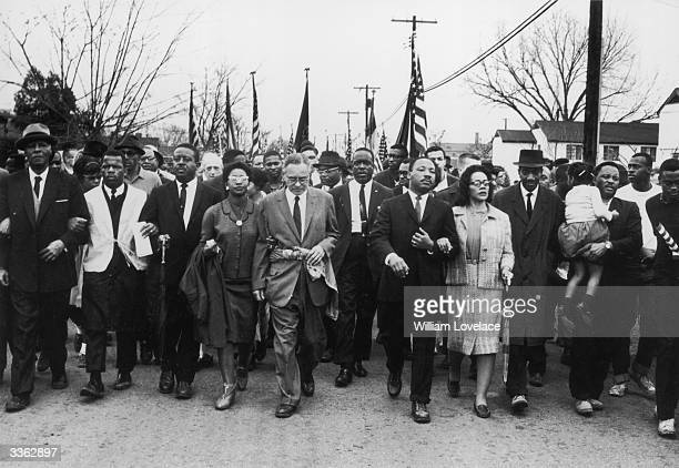American civil rights campaigner Martin Luther King and his wife Coretta Scott King lead a black voting rights march from Selma, Alabama, to the...