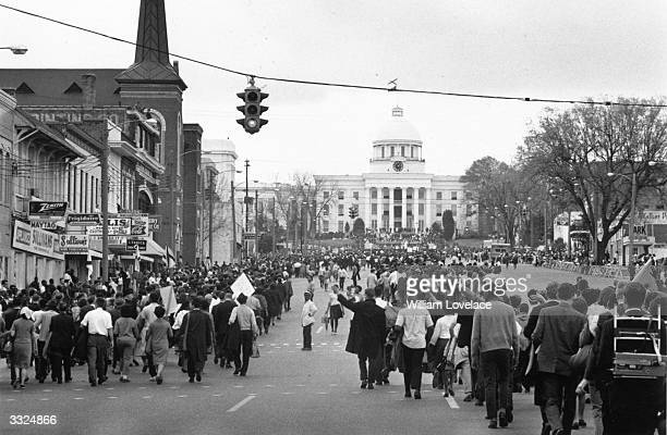 American civil rights demonstrators led by Dr Martin Luther King approach the Capitol Building in Montgomery Alabama at the end of their march for...