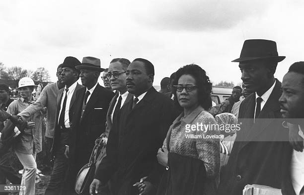 American civil rights leader Martin Luther King with his wife Coretta Scott King and colleagues during a civil rights march from Selma Alabama to the...