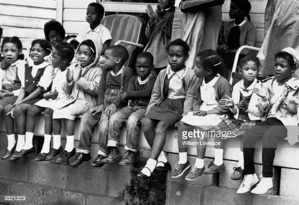 Children watching a black voting rights march in Alabama Dr Martin Luther King led the march from Selma Alabama to the state capital in Montgomery