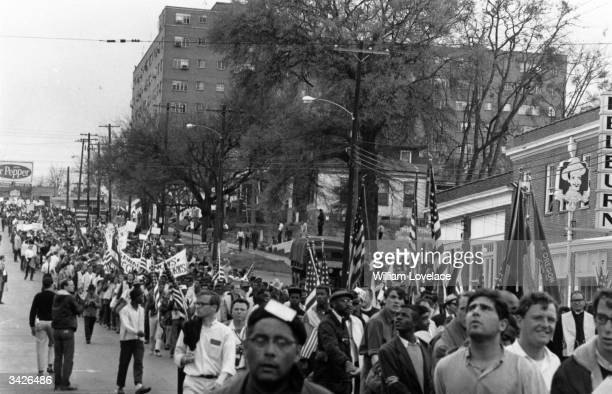 Civil rights protesters led by Dr Martin Luther King marching for black voting rights from Selma Alabama to the state capitol in Montgomery