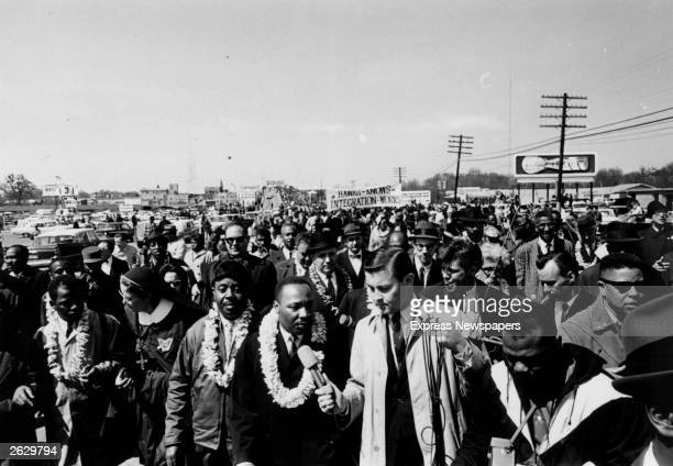 Martin Luther King leads the Alabama Civil Rights march flanked by supporters Next to him is fellow campaigner Ralph Abernathy