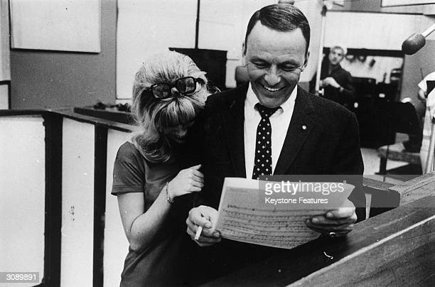 Frank Sinatra sharing a joke with his daughter Nancy during a joint recording session in Hollywood