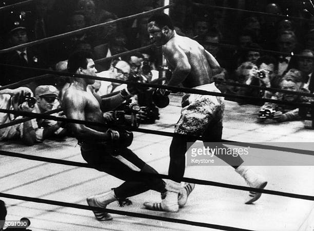 In a title fight at Madison Square Gardens, New York, Muhammad Ali goes down in the 15th round to a left hook from world heavyweight champion Joe...