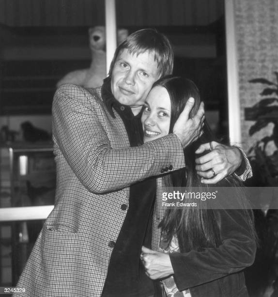 American actor Jon Voight hugs his wife actor Marcheline Bertrand at the Filmex Film Festival Los Angeles California