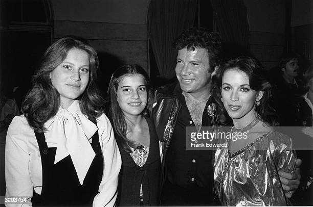 Canadianborn actor William Shatner smiles while standing with his arms around his second wife actor Marcy Lafferty and his daughters from a previous...