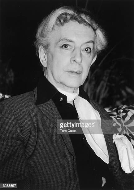 Headshot of British author Quentin Crisp at Freddy's Restaurant in New York City. He wears a light scarf.
