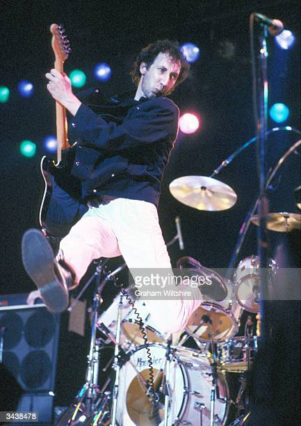 The Who's guitarist Pete Townshend leaps into the air during a performance