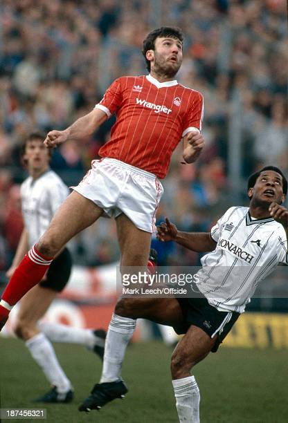 March 1984 Football League Division One - Notts County v Nottingham Forest, Forest striker Garry Birtles jumps higher than John Chiedozie.
