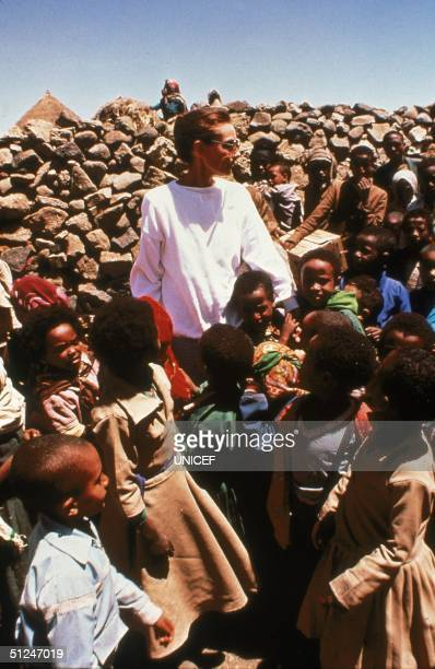 March 1988, Belgian-born actor and UNICEF Special Ambassador Audrey Hepburn stands with children in drought-stricken Ethiopia.