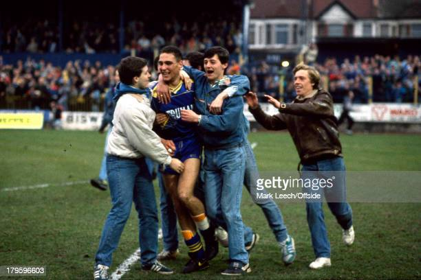 12 March 1988 FA Cup 6th Round Wimbedon v Watford Vinnie Jones is mobbed by celebrating Wimbledon fans as they invade the Plough Lane pitch