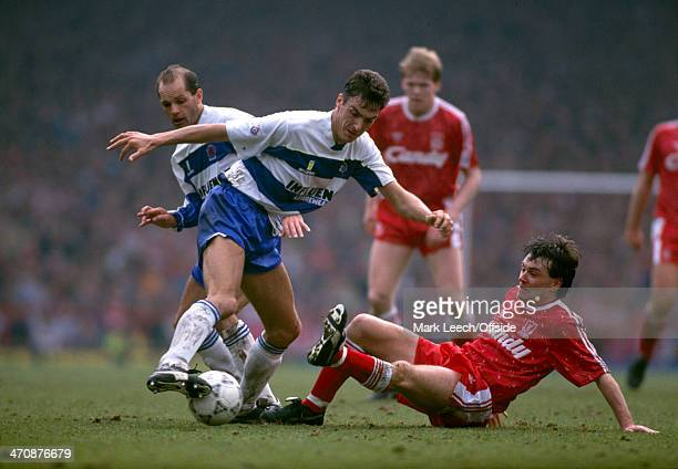30 March 1991 Football League Division One Queens Park Rangers v Liverpool Andy Tillson of QPR keeps the ball away from the sliding tackle of Ray...