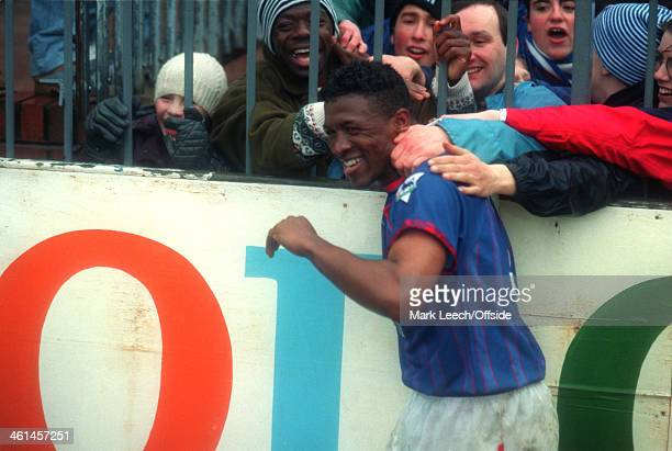 12 March 1994 FA Cup Quarter Final Bolton Wanderers v Oldham Athletic Oldham fans try to reach through the perimeter fence to grab winning goalscorer...