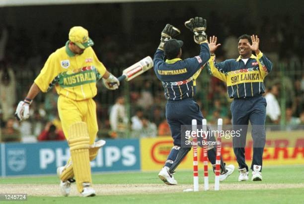Aravinda De Silva of Sri Lanka celebrates with Kaluwitharana after bowling Ricky Ponting during the Cricket World Cup Final between Australia and Sri...
