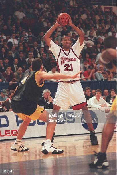 Center Marcus Camby of the University of Massachusetts looks to pass the ball during the Minutemen 92-70 win over Central Florida at Providence Civic...