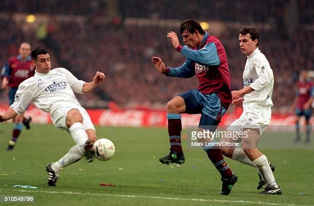 March 1996 - Coca Cola League Cup Final - Aston Villa v Leeds United - John Pemberton of Leeds tackles Savo Milosevic of Villa.