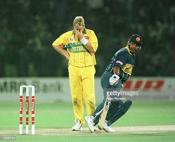 Shane Warne of Australia dejected as Ranatunga scores more runs during the Cricket World Cup Final between Australia and Sri Lanka played at the...