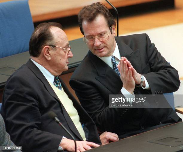 The former Federal Foreign Minister HansDietrich Genscher sits on his 70th birthday with his then successor Klaus Kinkel during the debate on tax...