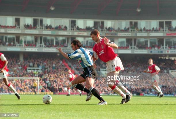 28 March 1998 London Premier League Football Arsenal v Sheffield Wednesday Paolo di Canio of Wednesday shields the ball from Tony Adams of Arsenal