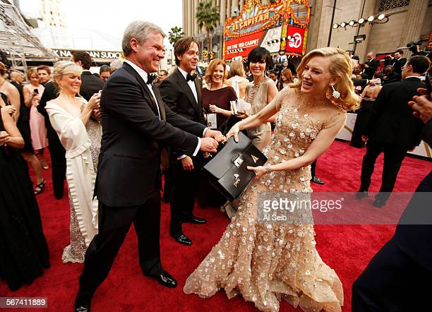 HOLLYWOOD CA March 2 2014 Cate Blanchett plays with ballot leader PwC's Brian Cullinan as she arrives at the 86th Annual Academy Awards on Sunday...