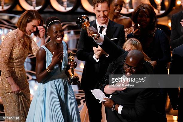 HOLLYWOOD CA – March 2 2014 Director Steve McQueen thrusts his fist in elation as he celebrates winning the Oscar for Best Picture with cast...