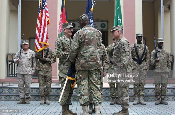 KABUL March 2 2016 US army General John F Campbell right outgoing commander of the NATOled Resolute Support in Afghanistan and US forces hands a flag...