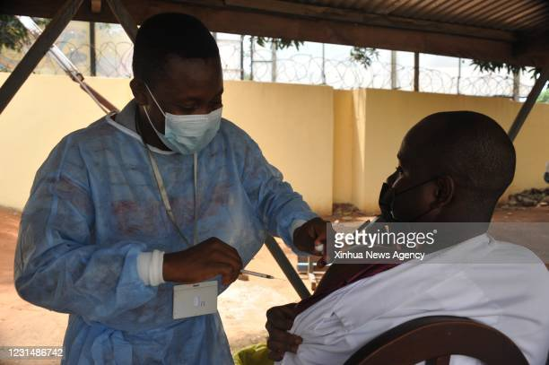 March 2, 2021 -- A nurse administers the COVID-19 vaccine to a man at a hospital in Accra, Ghana, on March 2, 2021. The government of Ghana Tuesday...