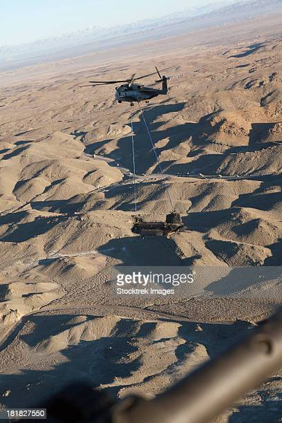 March 20, 2011 - A CH-53E Super Stallion transports a U.S. Army CH-47 Chinook during a helicopter recovery mission over Afghanistan.
