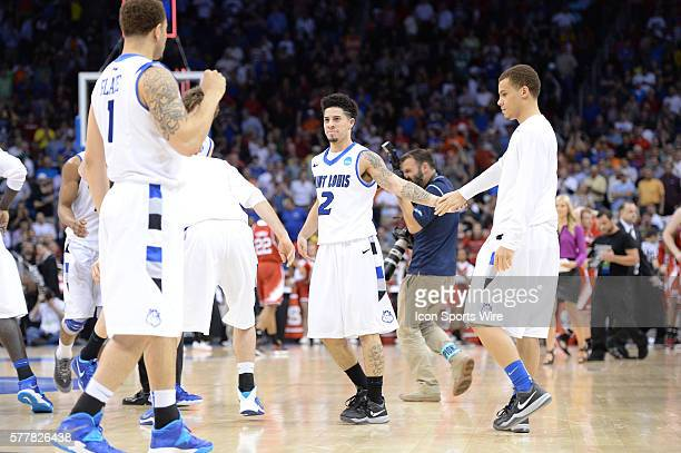 G Austin McBroom of the Saint Louis Billikens celebrates with at teammate after defeating the NC State Wolfpack in the Second Round of the NCAA...